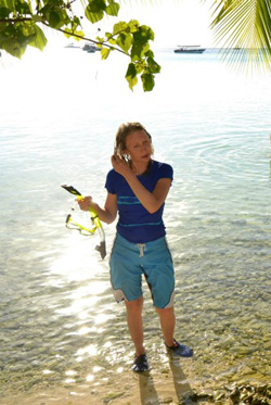 Mum with rash vest, board shorts and reef shoes